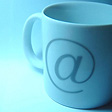 Pic of a mug decorated with the at symbol (@)